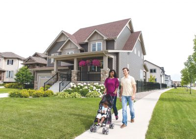 Family walking down street