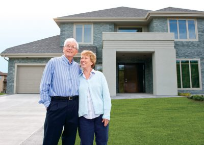 Couple in front of home