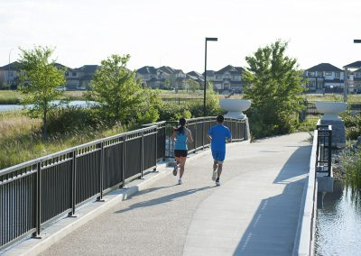 Couple jogging on bridge