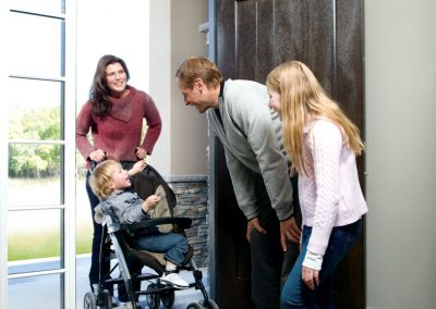 Family entering visitable home