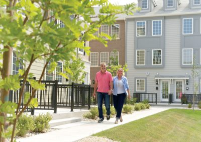 Couple going for walk through courtyard